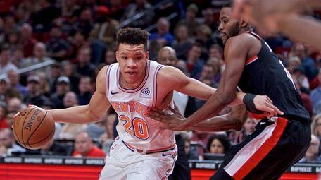 New York Knicks forward Kevin Knox, left, drives