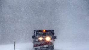 A plow drives through Sunken Meadow State Park