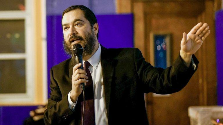 Hempstead schools Superinentendent Shimon Waronker gives a presentation