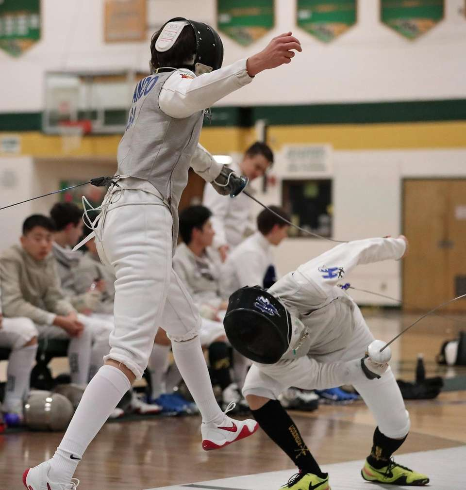 Commack's Joon Lee (right) ducks under the parry