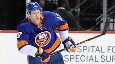 Islanders left wing Matt Martin skates to the