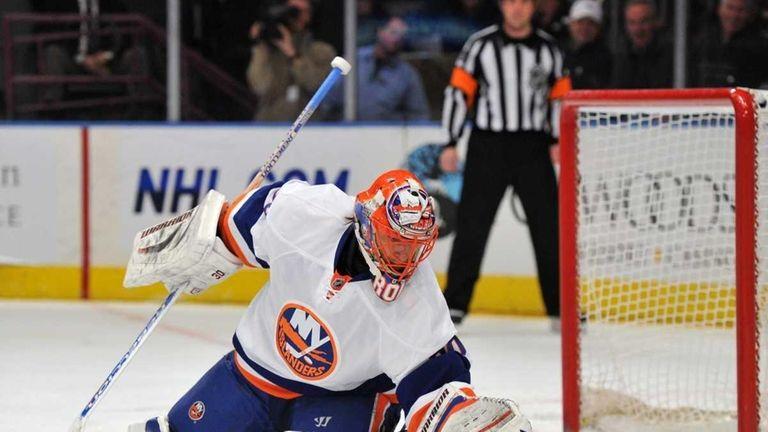 New York Islanders goaltender Dwayne Roloson (30) stops