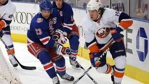The Islanders' P.A. Parenteau, right, and the Rangers'
