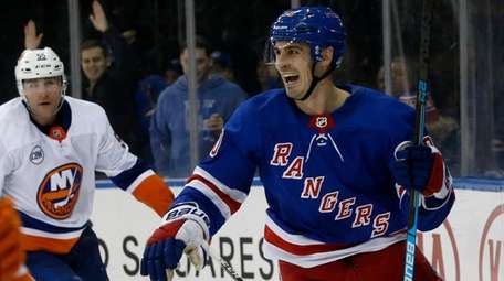 The Rangers' Chris Kreider celebrates his third-period goal