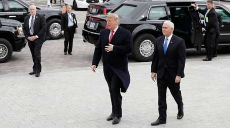 President Donald Trump arrives with Vice President Mike