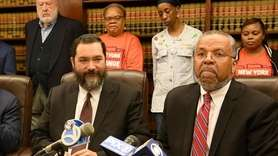 Hempstead schools Superintendent Shimon Waronker and his attorney,