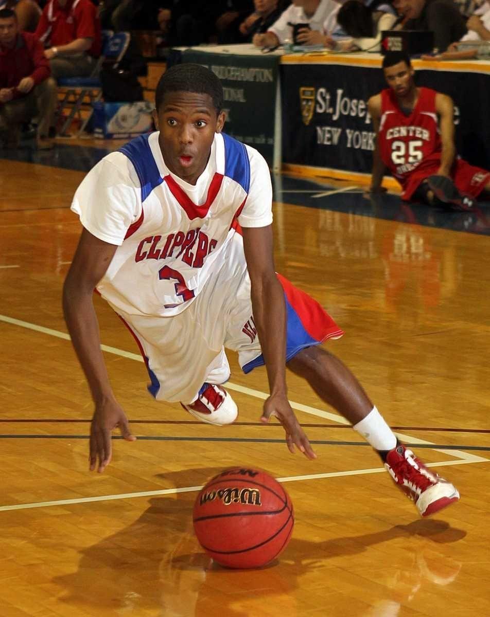 Bellport's Darian Trent (3) drives to the hoop