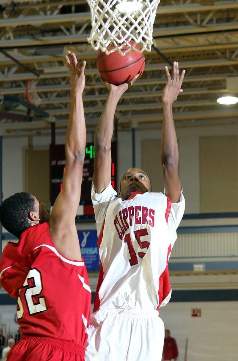 Bellport's Travis Correa(15) shoots over Center Moriches' Elijah