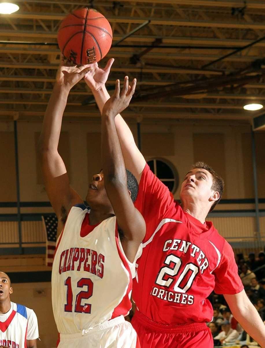 Center Moriches' John March (20) blocks the shot