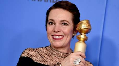 Olivia Colman with her Golden Globe for best