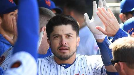 Mets catcher Travis d'Arnaud is greeted in the