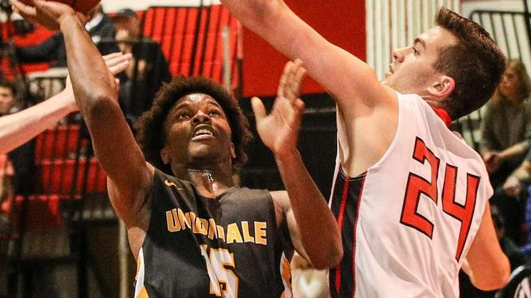 Syosset's Andrew Newman blocks the shot of Uniondale's