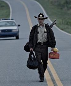"Zombies in a scene from ""The Walking Dead."""