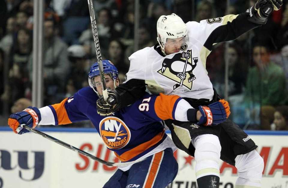 Sidney Crosby of the Pittsburgh Penguins collides with