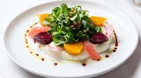 Wine-braised beets are set on whipped ricotta, with