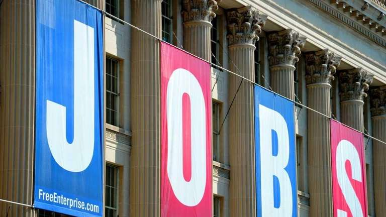 A jobs sign is seen on the front