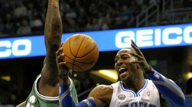 Magic center Dwight Howard, right, goes up for