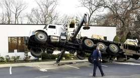 A large crane tipped over onto its side,