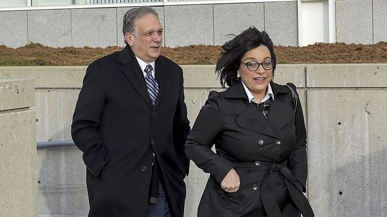 Edward Mangano and his wife, Linda, arrive at