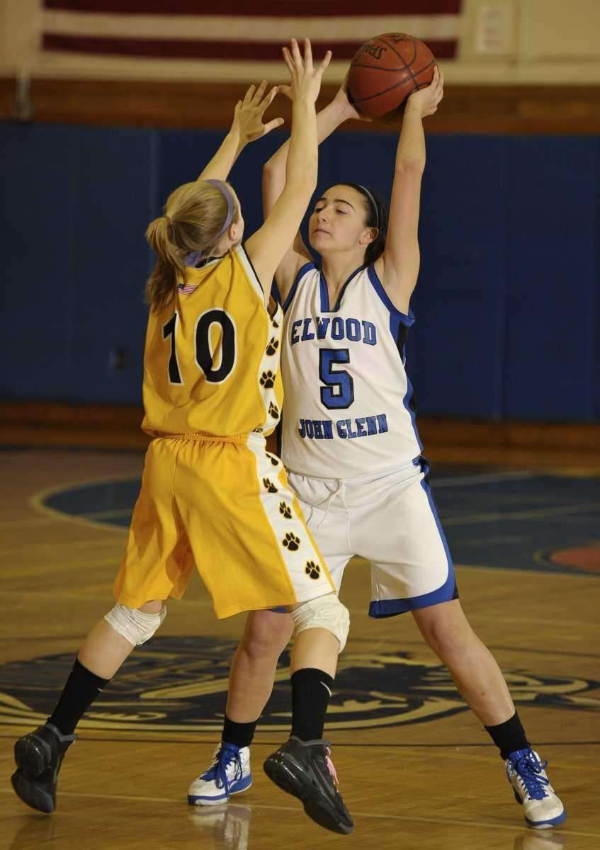 Glenn's Mackenzie Sivilli, right, looks to pass guarded
