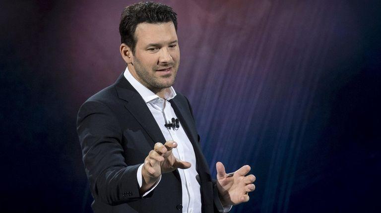 Tony Romo speaks during a keynote address at