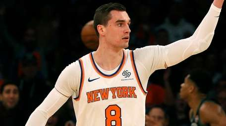 The Knicks' Mario Hezonja reacts after dunking against