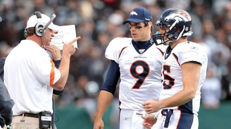 Adam Gase speaks to Brady Quinn #9 and