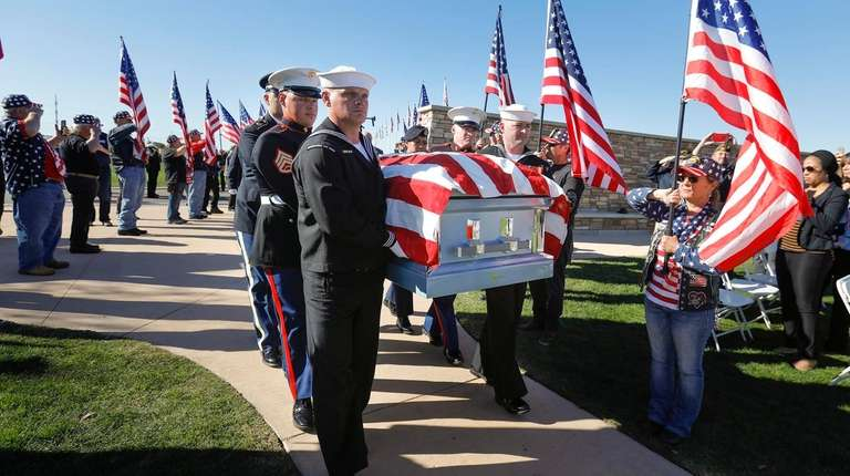 The coffin of Navy veteran Ray Chavez, who