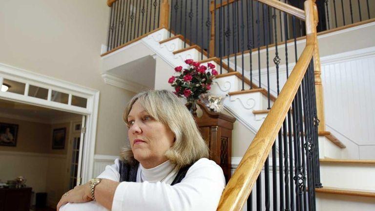 Realtor Lynn Barlow poses for a portrait in