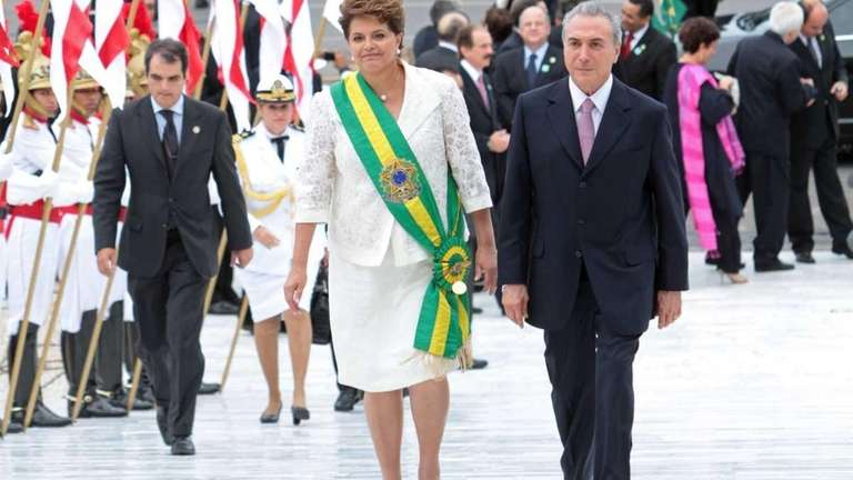 Wearing the green-and-gold presidential sash, newly-elected Brazilian President