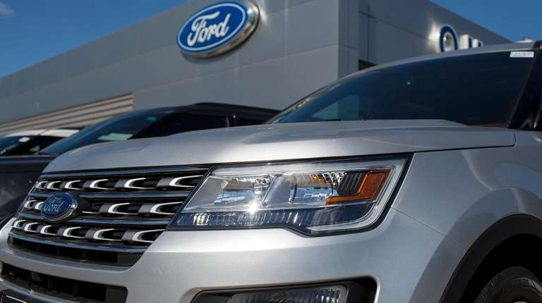 Vehicles at a Ford dealer in Quincy, Mass.,