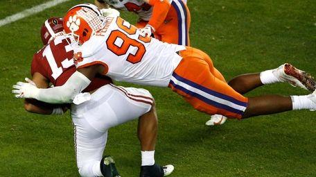 Clemson's Clelin Ferrell tackles Alabama QB Tua Tagovailoa