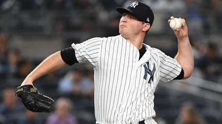 Yankees relief pitcher Zach Britton delivers against the