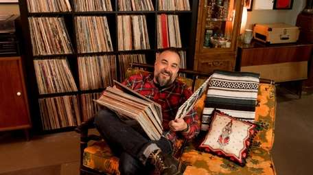 Norm Morales in his basement record room at