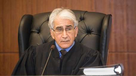 Judge Jerry Garguilo listens to testimony during a
