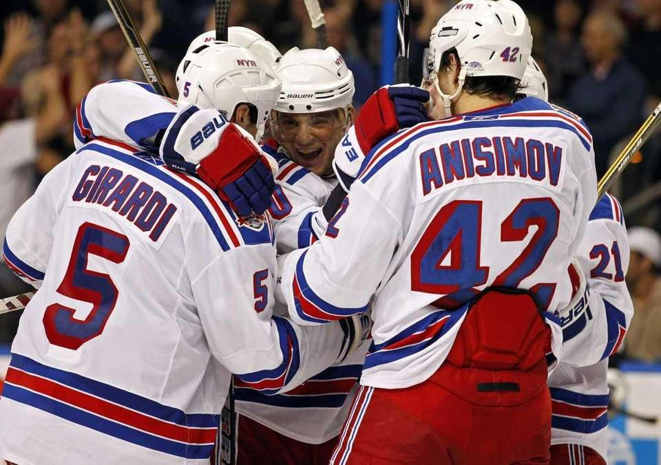 New York Rangers' Marian Gaborik, center, is congratulated