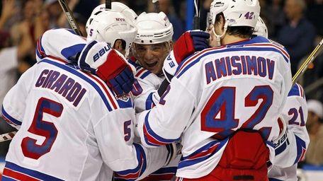 New York Rangers' Marian Gaborik, center, is congratulated