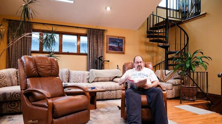 Bruce Levine in the living room of his
