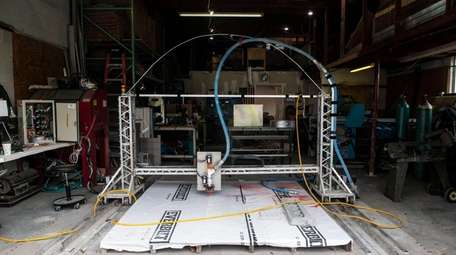 A small version of S-Squared's 3D printer is