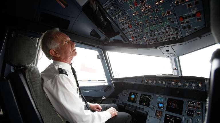 "Captain Chesley ""Sully"" Sullenberger sits in the cockpit"