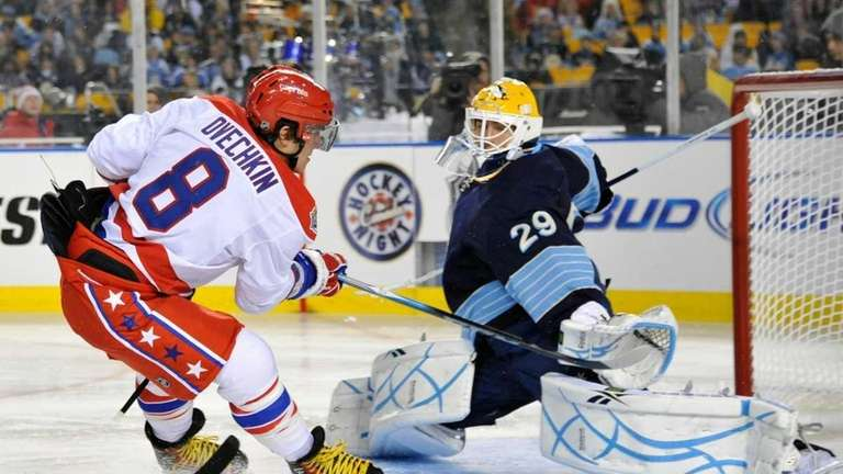 806618abf01 Alex Ovechkin  8 of the Washington Capitals shoots