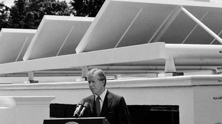 President Jimmy Carter speaks against a backdrop of