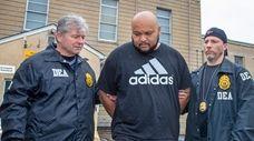 DEA agents escort Miguel Angel Corea Diaz from