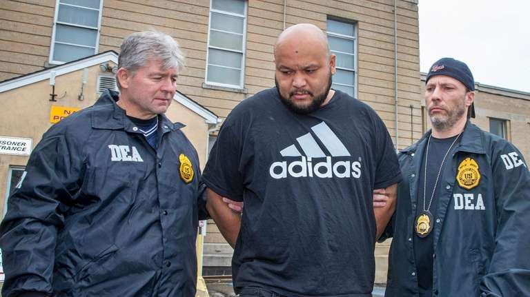 DEA agents escort Miguel Angel Corea Diaz from