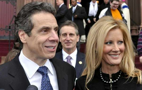 New York's new Governor Andrew Cuomo, left, with