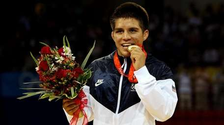 Team USA wrestler Henry Cejudo poses with his