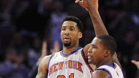 New York Knicks' Wilson Chandler (21) high-fives with