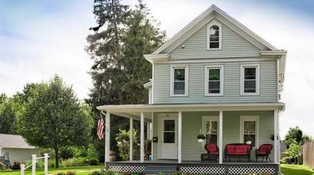 This Greenport farmhouse is listed for $999,000.
