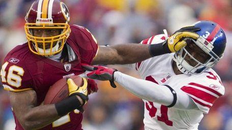 Washington's Ryan Torain (46) gives a stiff arm
