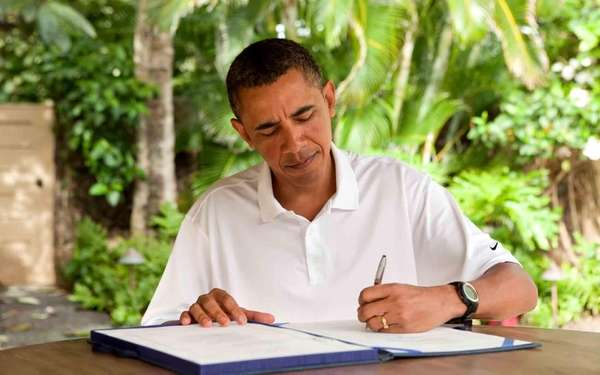 President Barack Obama signs the James Zadroga 9/11